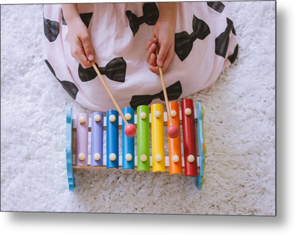 Toddler Playing A Xylophone At Home Metal Print by Suphat Bhandharangsri Photography