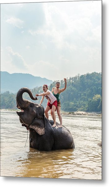 Two Young Women Riding An Elephant In The Mekong Metal Print by Matteo Colombo