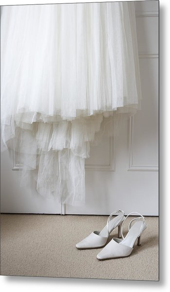 White Shoes On Floor Beneath Wedding Dress Hanging Outside Wardrobe Metal Print by Michael Blann