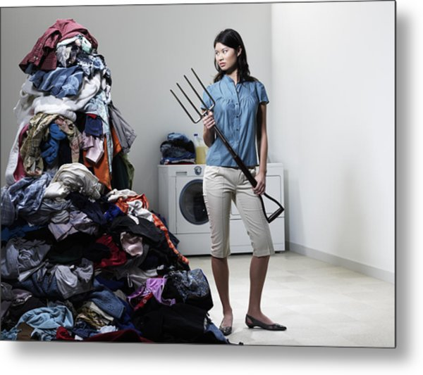 Woman Next To Pile Of Laudry With Pitchfork. Metal Print by Ryan McVay