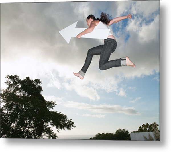 Woman With Blank Arrow Leaping Outdoors Metal Print by Robert Daly