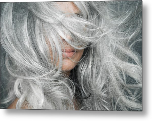 Woman With Grey Hair Blowing Across Her Face. Metal Print by Andreas Kuehn