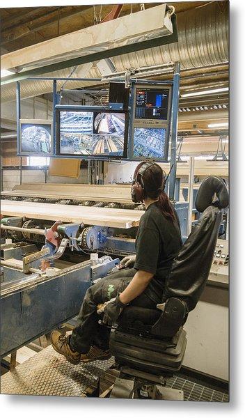 Young Woman Using Control Panel While Monitoring Computer Screens At Sawmill Metal Print by Hakan Jansson