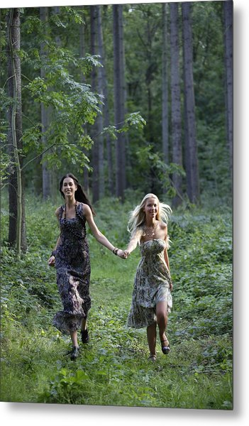 Young Women Running Through Forest Metal Print by Asia Images