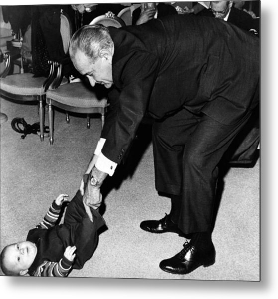 President Lyndon Johnson Tugs The Legs Metal Print by Everett