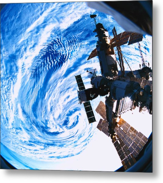A Space Station Orbiting Above Earth Metal Print