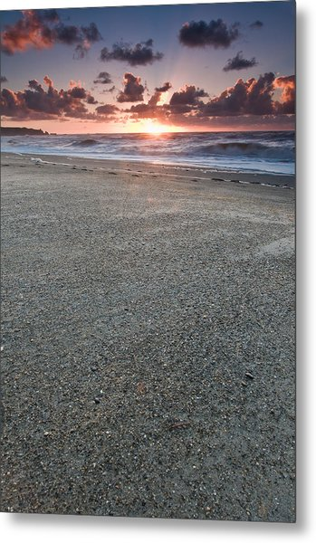 A Beach During Sunset With Glowing Sky Metal Print