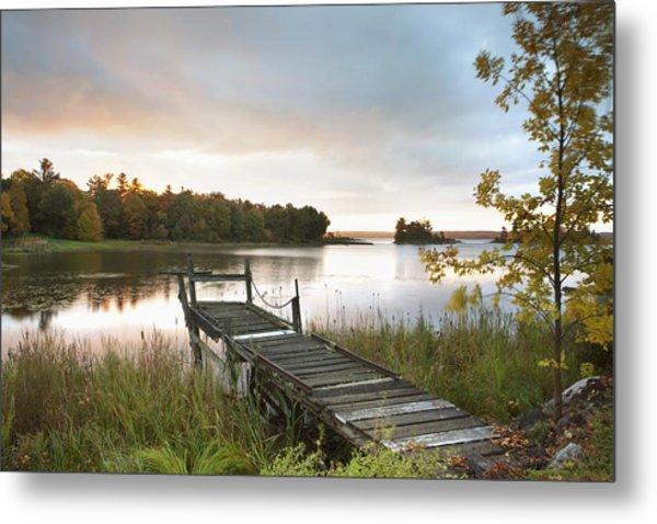 A Dock On A Lake At Sunrise Near Wawa Metal Print