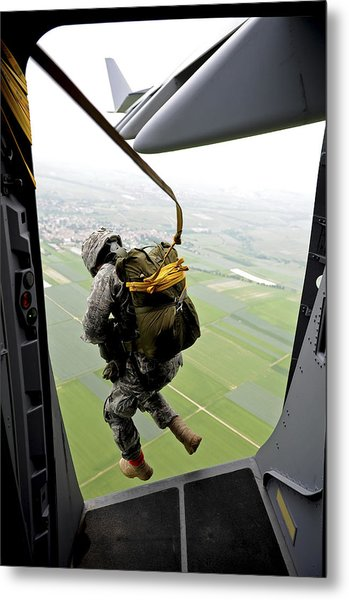 Metal Print featuring the photograph A Paratrooper Executes An Airborne Jump by Stocktrek Images