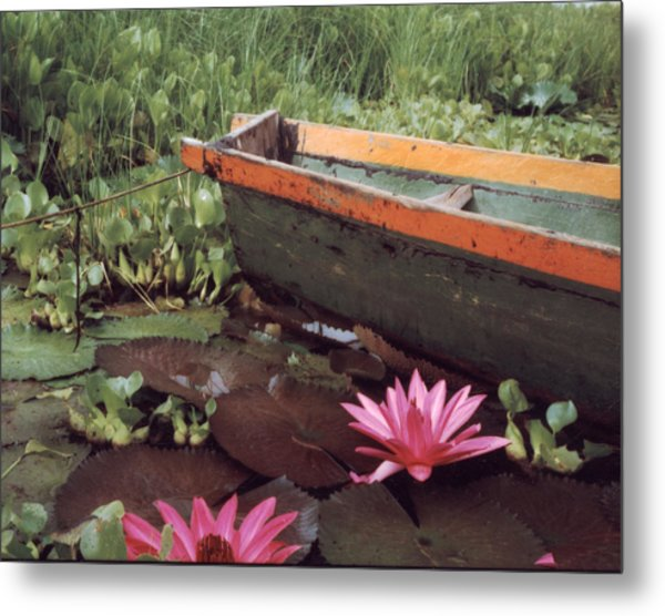 Colombian Boat And Flowers Metal Print by Lawrence Costales