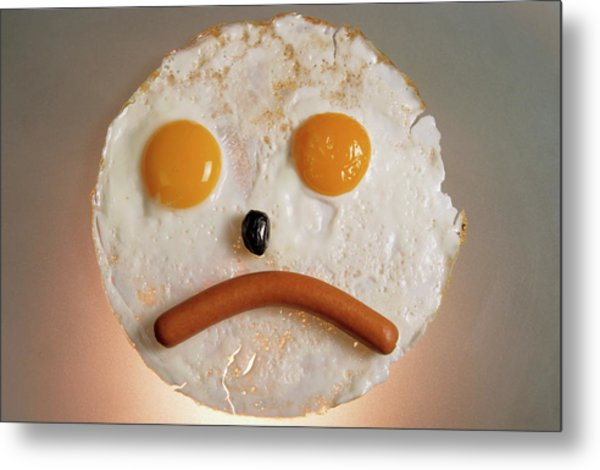 Fried Breakfast Of Eggs And Sausage Made Into A Frowning Face Metal Print by Sami Sarkis