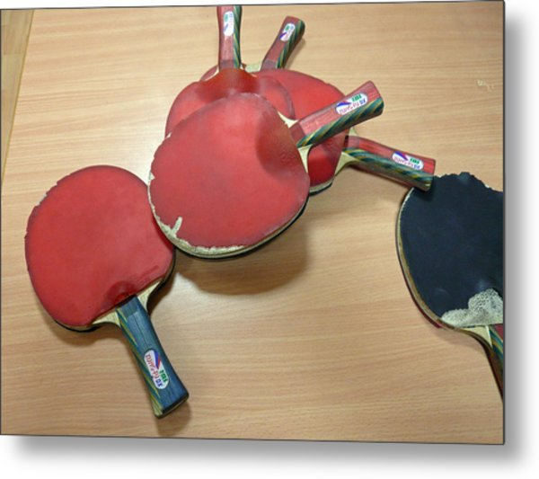 Number Of Ping Pong Bats Piled On A Table Metal Print