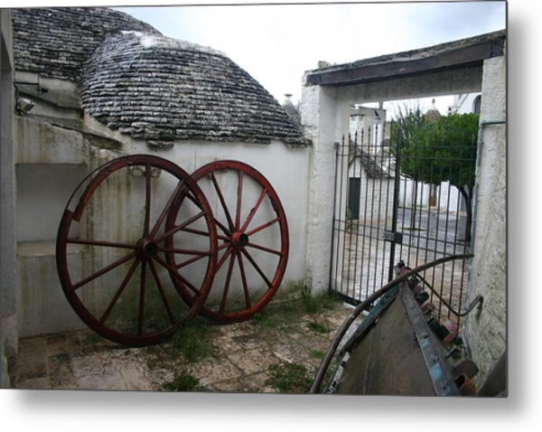 Old Wagon Wheels Metal Print by Dennis Curry