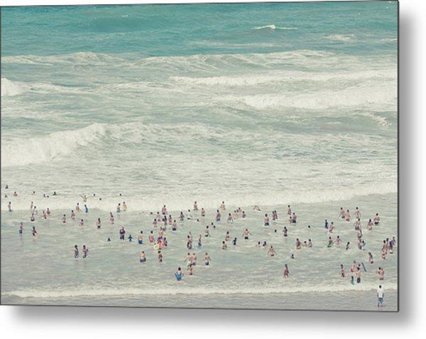 People Walking Into Ocean Metal Print