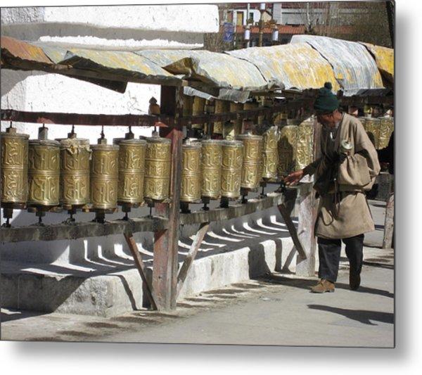 Spinning The Prayer Wheels In Lhasa  Metal Print by James Lukashenko