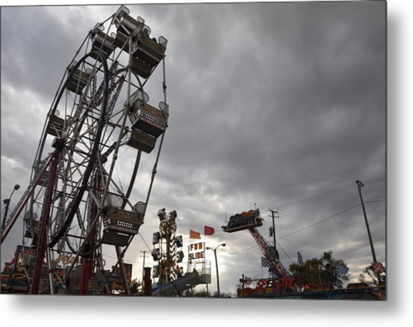 Stormy Ferris Wheel Metal Print by Daniel Ness