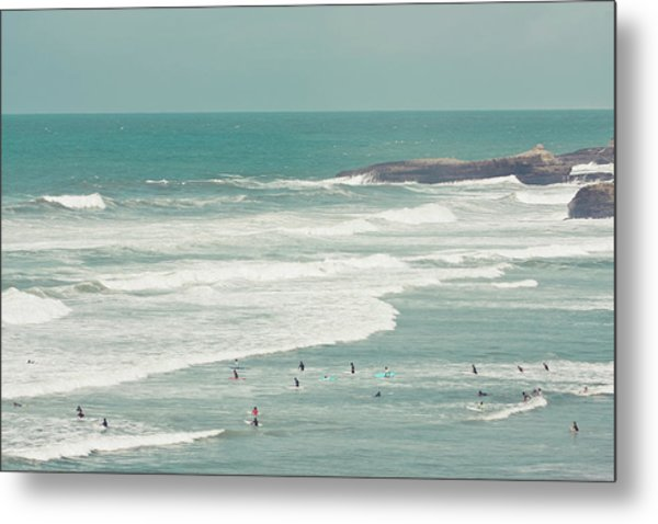 Surfers Lying In Ocean Metal Print