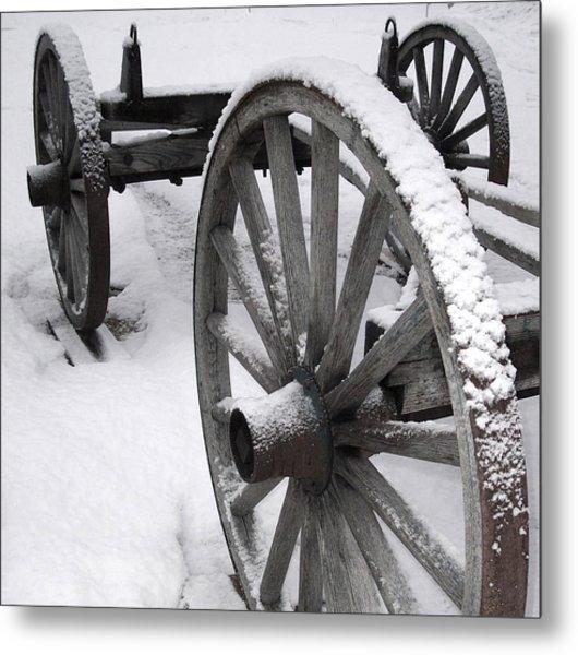 Wagon Wheels In Snow Metal Print by Linda Drown