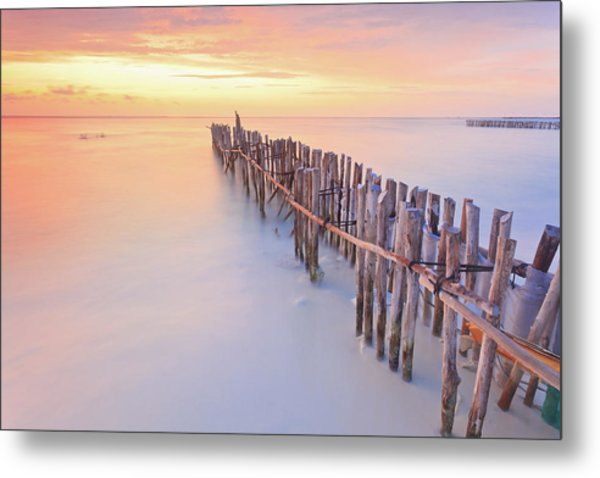 Wooden Posts Into  Sea Metal Print