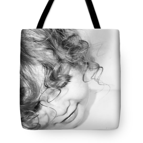 Tote Bag featuring the photograph An Angels Smile - Black And White by Kerri Ligatich