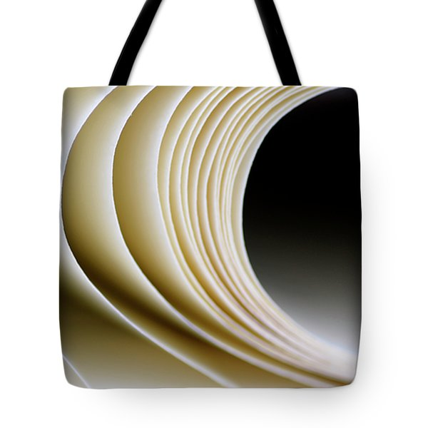 Tote Bag featuring the photograph Paper Curl by Pedro Cardona