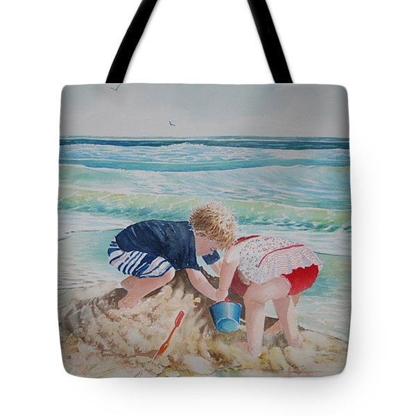 Saving The Sand Castle From The Tide Tote Bag by Tom Harris