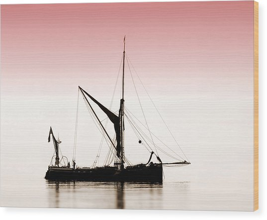 Coble Sailing  Against Pint Sky Wood Print