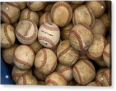 One Clean Baseball Sitting In A Pile Acrylic Print by Phil Schermeister