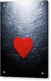 Red Felt Heart On Stainless Steel Background. Acrylic Print by Ballyscanlon