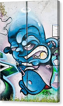 Angry Blue Creature With A Spray-paint Can Canvas Print