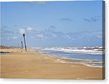 Beach With Breakwater In The Distance Canvas Print by Jon Boyes