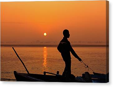 Boatsman On The Ganges Canvas Print by Stefan Nielsen