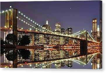 Brooklyn Bridge At Night Canvas Print by Sean Pavone