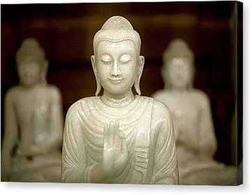 Buddha Statuettes At The Temple Canvas Print by David Evans