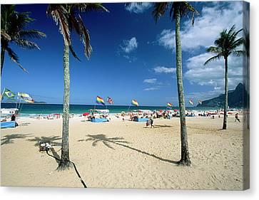 Ipanema Beach With Rainbow Flags Canvas Print by George Oze