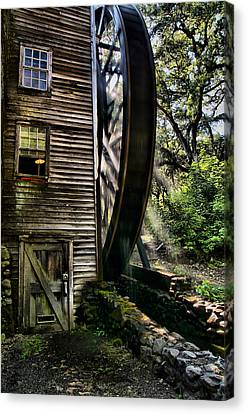 Old Water Wheel Canvas Print by Michael  Ayers
