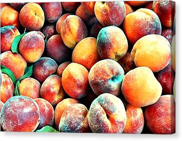 Peaches Canvas Print by Carlos Avila