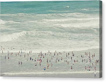 People Walking Into Ocean Canvas Print by Cindy Prins