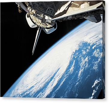 Space Shuttle In Outer Space Canvas Print by Stockbyte