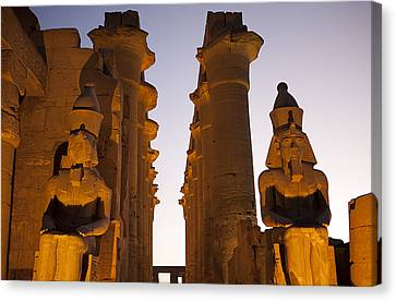 Statues Of Ramses II Rest In The Sunset Canvas Print by Taylor S. Kennedy