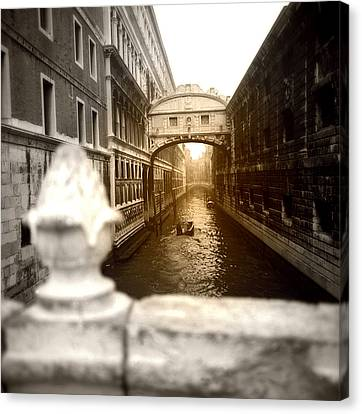 Venice Canal With Sunlight Canvas Print by Emanuel Tanjala
