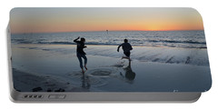 Portable Battery Charger featuring the photograph Kids At The Beach by Robert Meanor