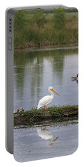 Portable Battery Charger featuring the photograph Pelican Reflection by Alyce Taylor
