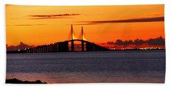 Sunset Over The Skyway Bridge Beach Towel