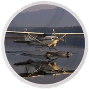 Reflections Of A Float Plane Round Beach Towel by Darcy Michaelchuk