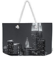 Empire State And Chrysler Buildings At Twilight II Weekender Tote Bag by Clarence Holmes