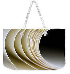 Weekender Tote Bag featuring the photograph Paper Curl by Pedro Cardona