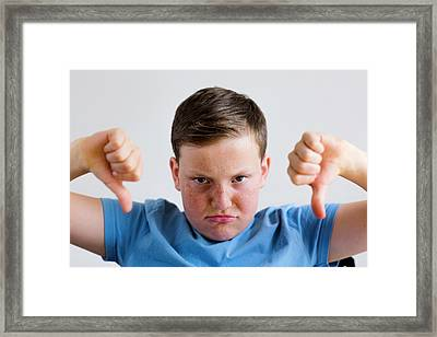 Boy With Thumbs Down Framed Print