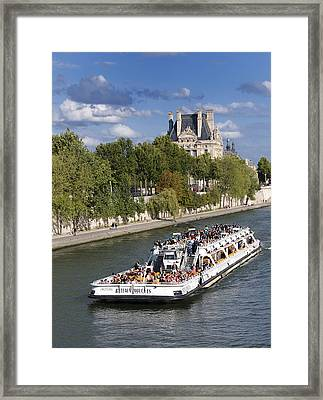 Sightseeing Boat On River Seine To Louvre Museum. Paris Framed Print by Bernard Jaubert