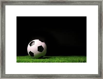 Soccer Ball On Grass Against Black Framed Print by Sandra Cunningham